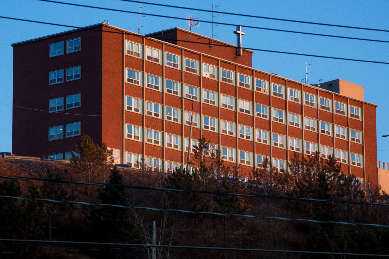 Click thumbnail to see details about photo - St Joes Hospital Facade With Cross in Saint John Photograph