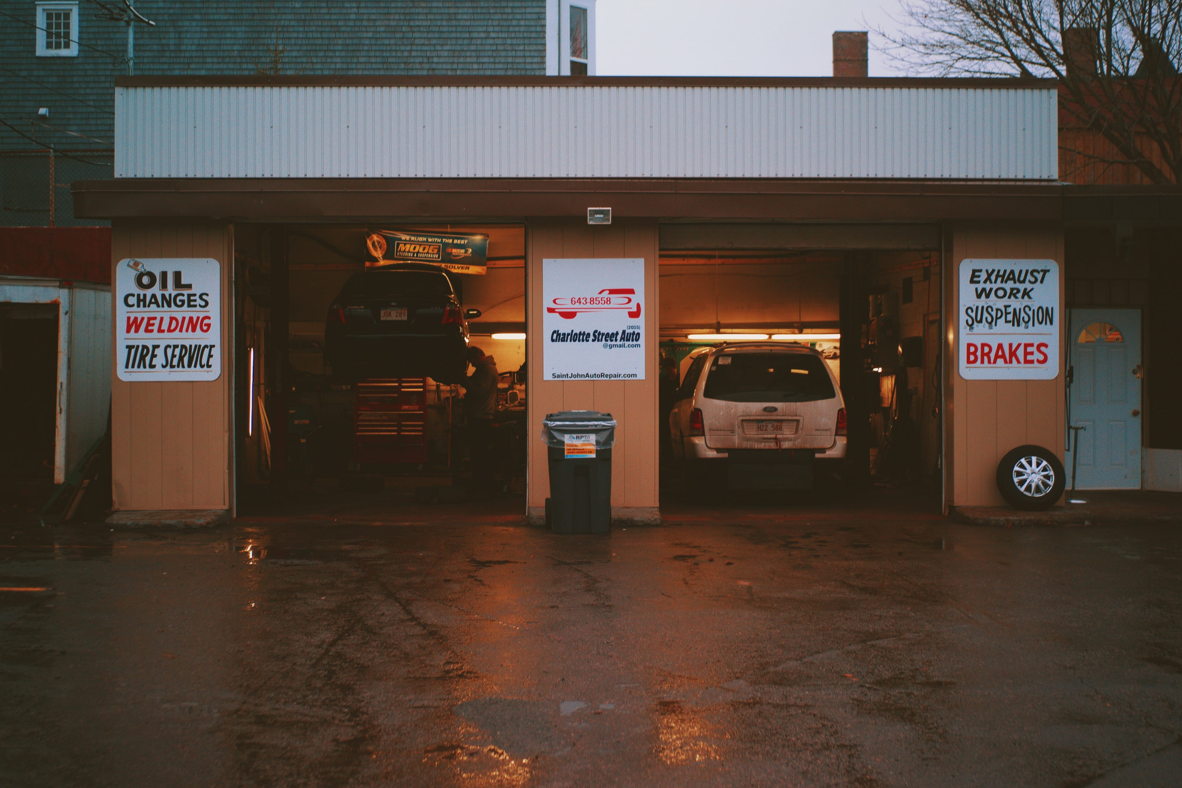 A photograph depicting Charlotte Street Auto Garage at Dusk