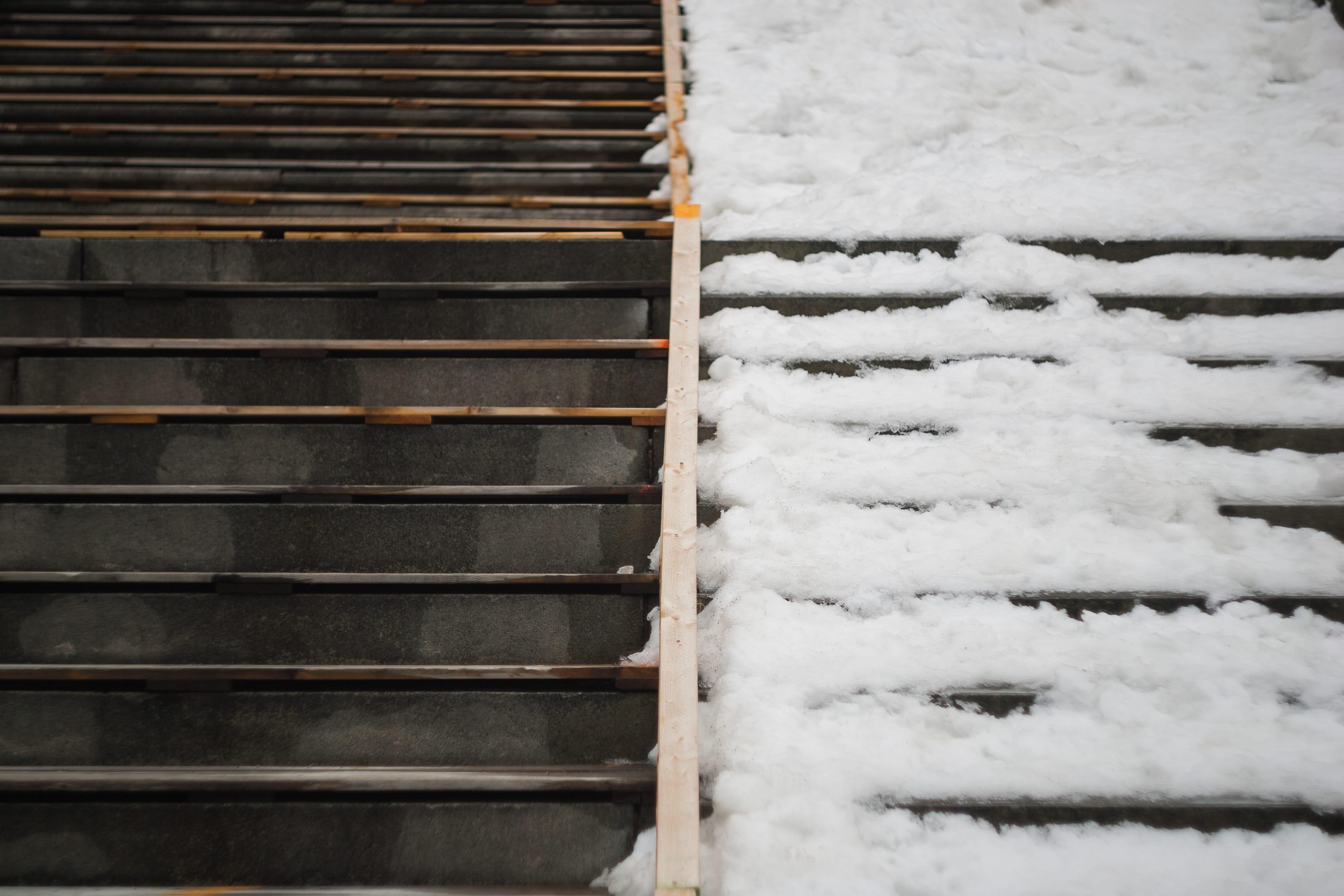 A photograph depicting Half and Half Snowy Steps Saint John Highschool