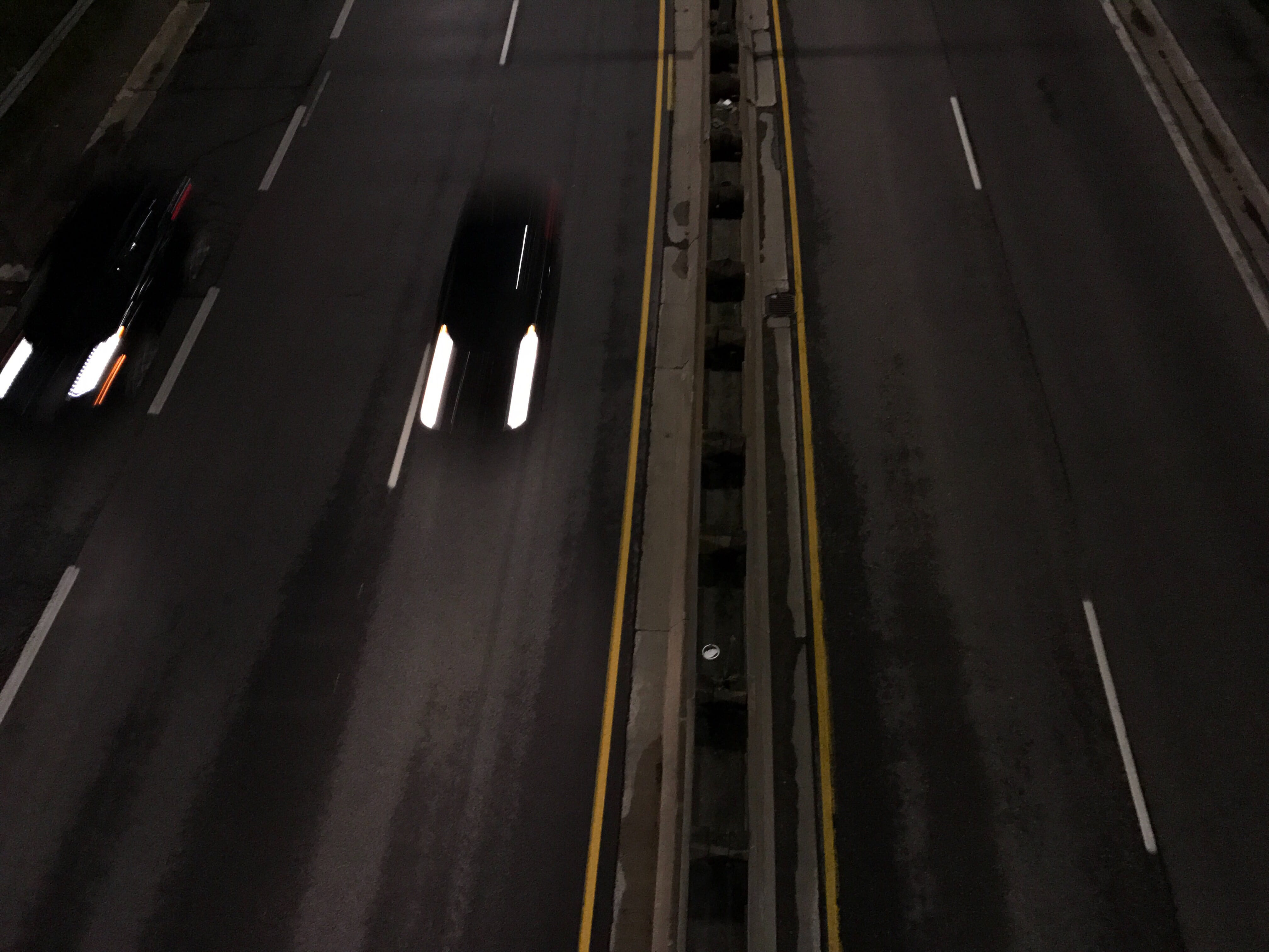 A photograph depicting Looking Down Overpass at Night