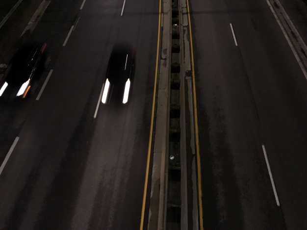 Looking Down Overpass at Night Photograph
