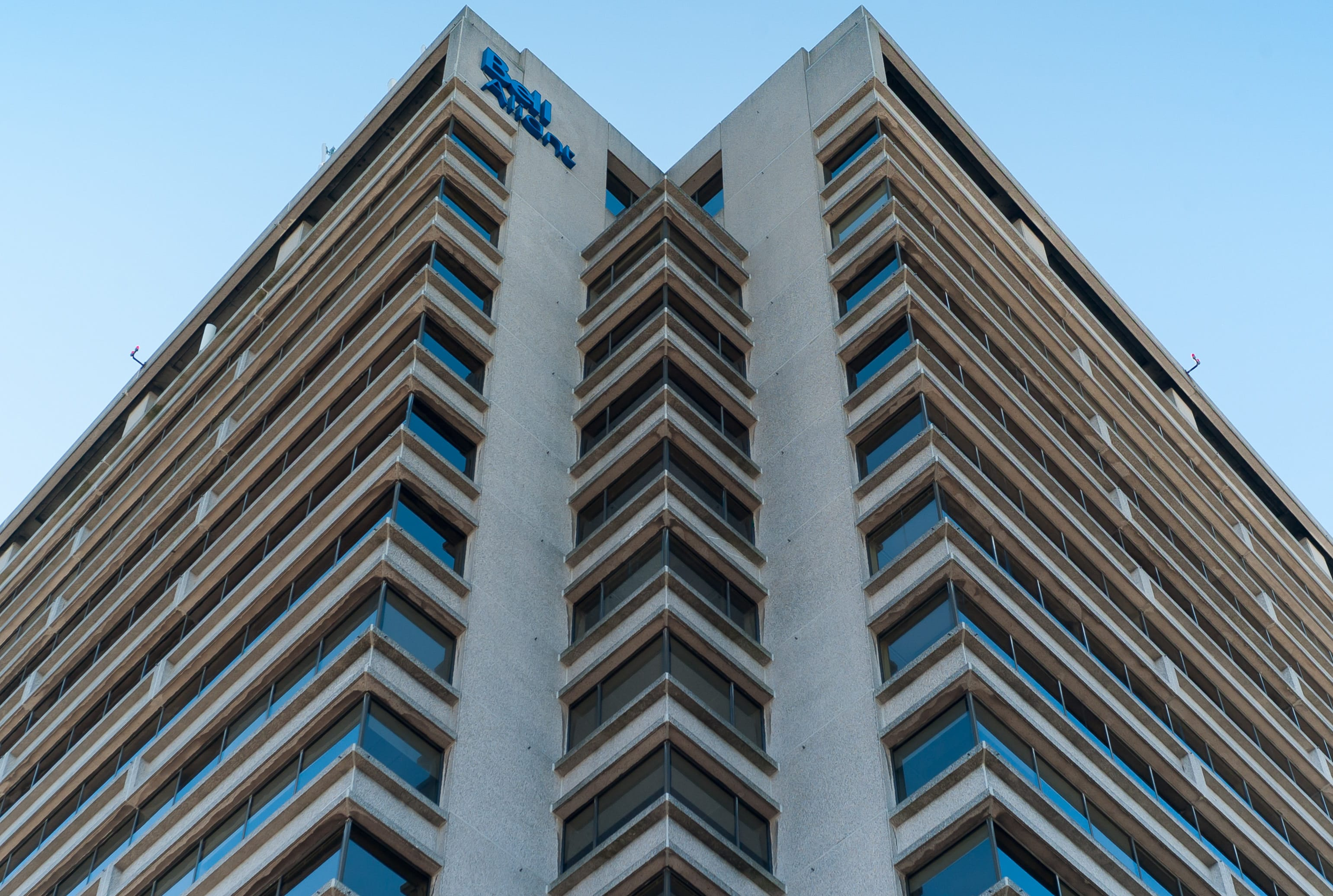 A photograph depicting Looking up at Bell Aliant Building