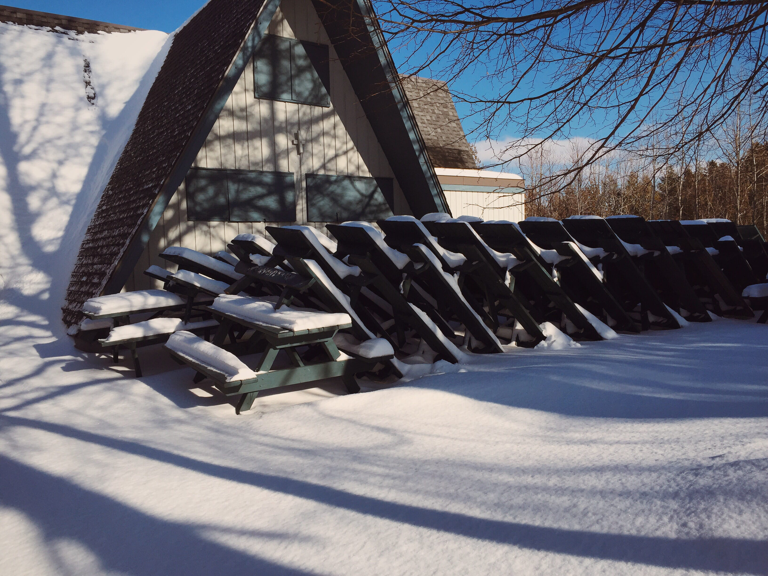A photograph depicting Patio Tables Stacked for the Season Rockwood Park Sj