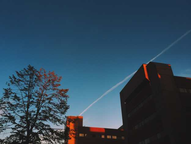 Red Hospital Highlights at Dusk Photograph