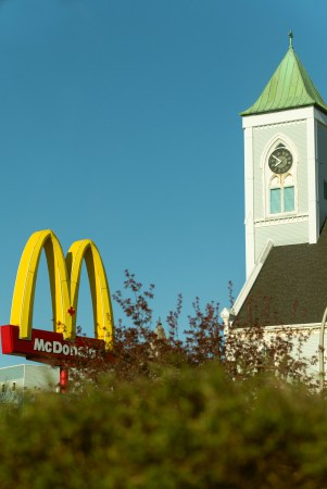 A photo of Mcdonalds and a Church Steeple