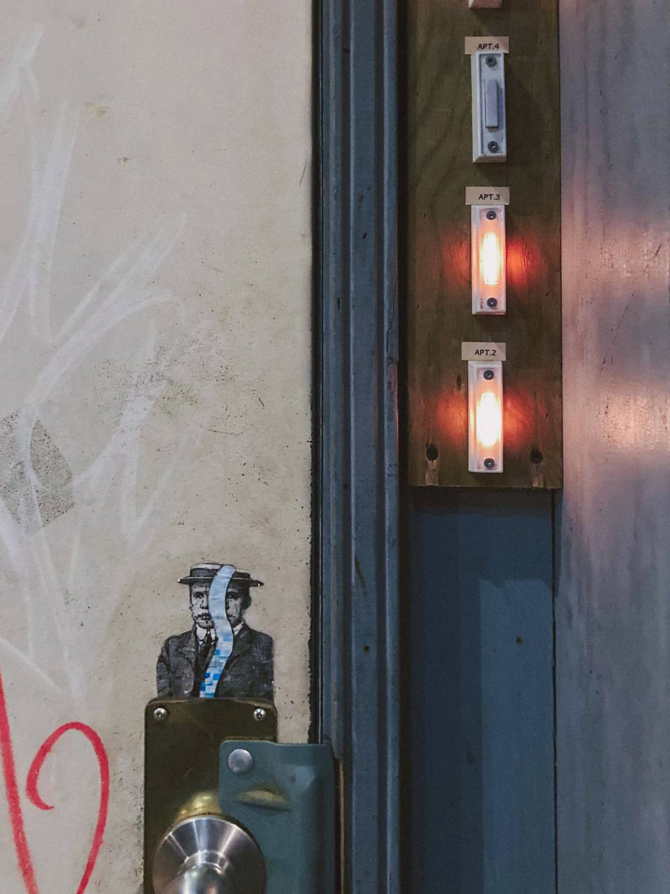 A photo of lighted door bells on grannan street