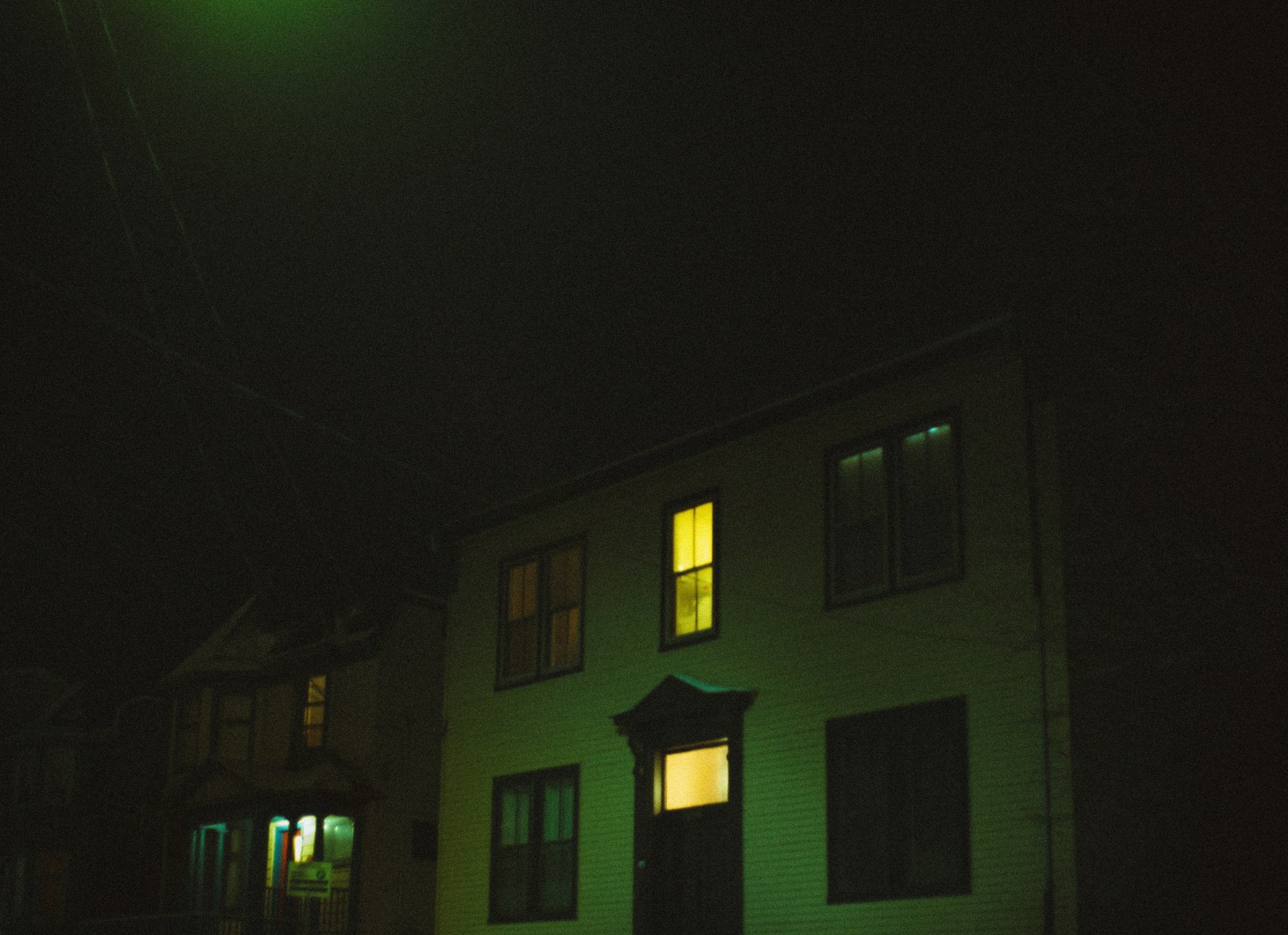 A photo of South Side house at night