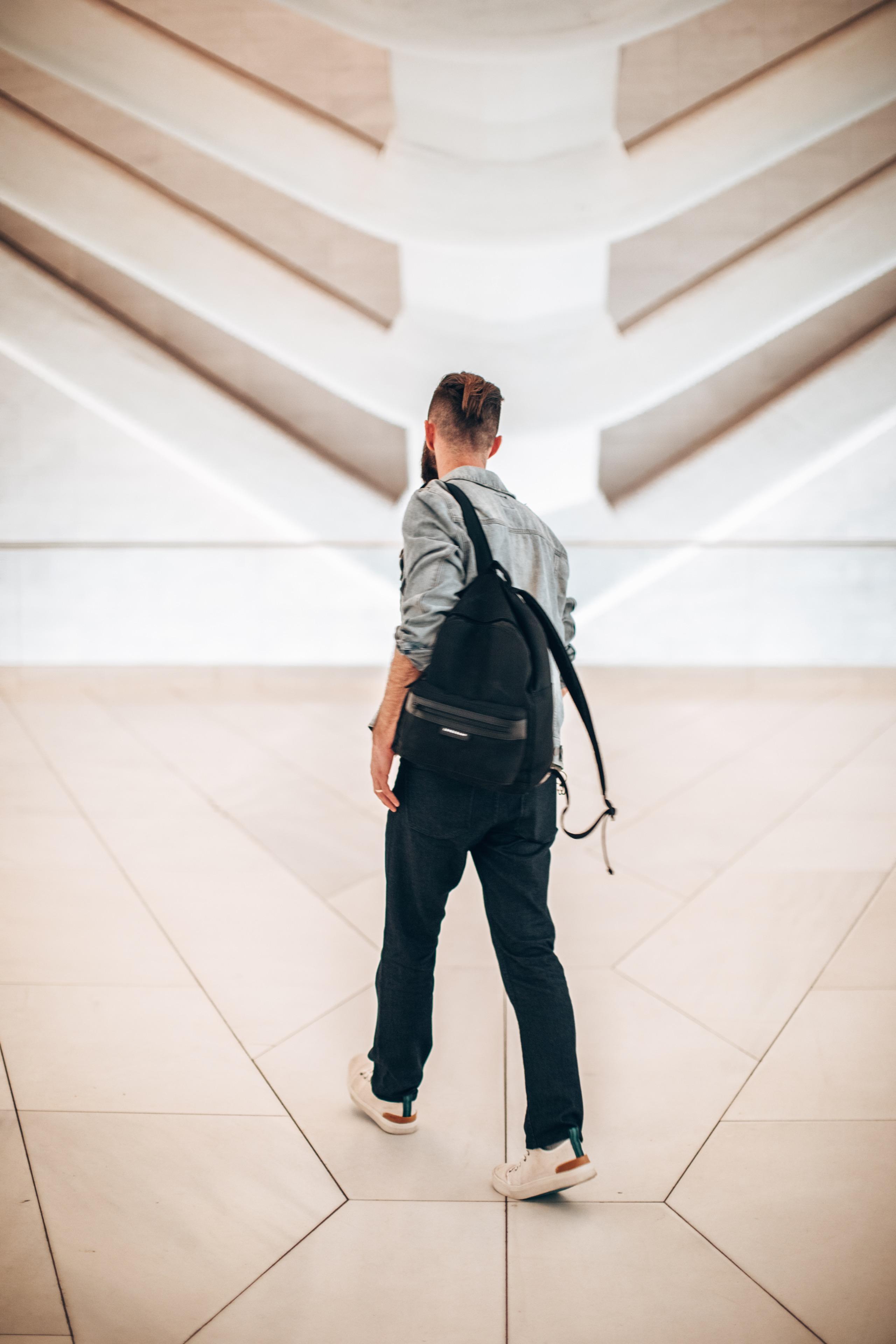 man walking away in the Oculus building in NYC