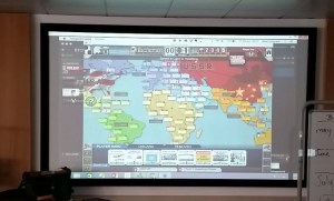 Digital version of Twilight Struggle mirrored to projector screen in my lab