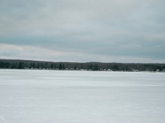 This is a tight crop of an otherwise uneventful picture, but you can clearly see the houses across the frozen lake which are about half a mile away.