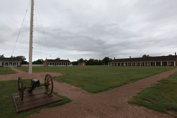 A howitzer and the barracks at Fort Larned