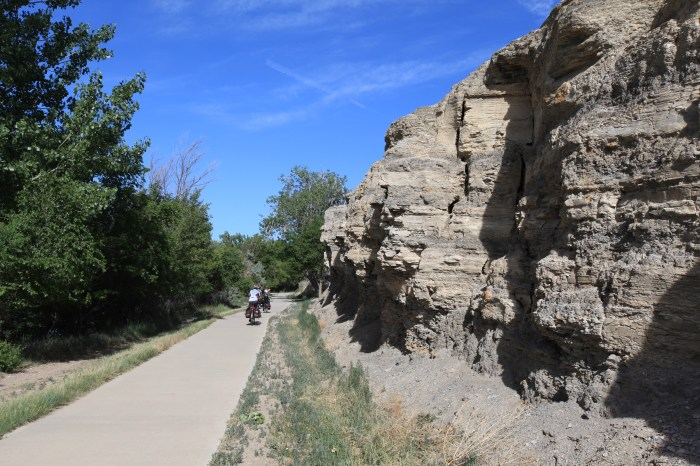 The reservoir path leaving Pueblo. Chuck thought the rock wall looked like faces.