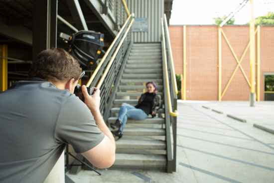 picture of atlanta photographer taking portrait of female model on Atlanta steps