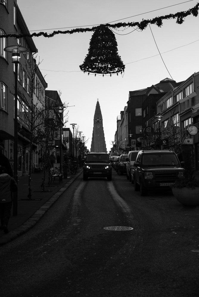 The large Lutheran church, Hallgrímskirkja, in Reykjavik, Iceland from the bottom of the main shopping road during Christmas time. Photo by Mike Higdon