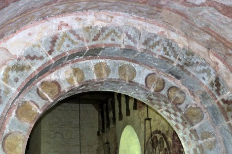 The chancel side of the Norman arch leading from the chancel to the nave.
