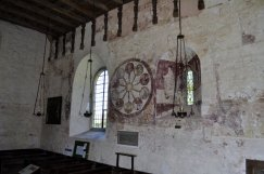 The north wall with its paintings of the Wheel of Life, and those of St Anthony of Egypt and St Michael and the Virgin, either side of window.