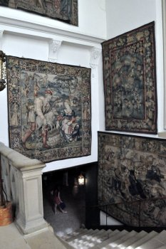 Tapestries at the top of the main stairs on the second floor.