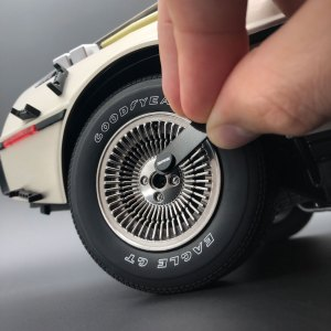 Removing DeLorean Magnetic Wheel Caps using magnetic tab