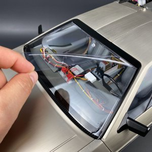 Applying Static Cling Window Protector to Eaglemoss DeLorean