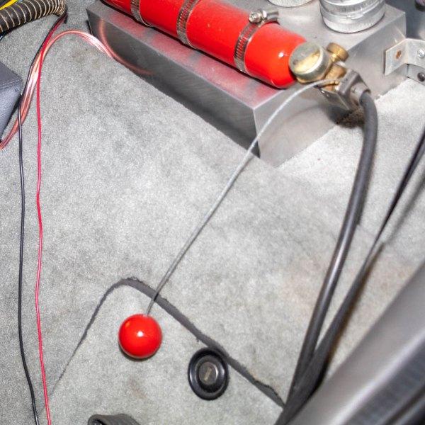 Original DeLorean bulkhead storage lid, bailout ball and wire