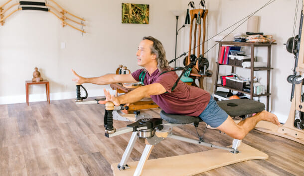 Mike Luque doing the Gyrotonic Iguana exercise