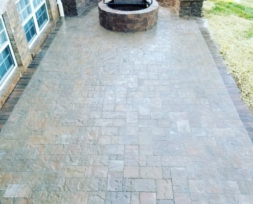 Paver Patio with Stone Bench and Stone Fire Pit