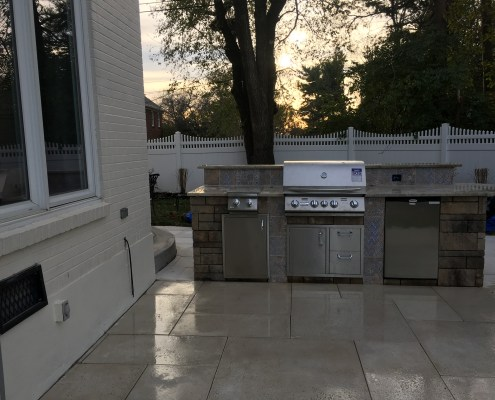 Paver Patio with Custom Built in Grill and Fridge