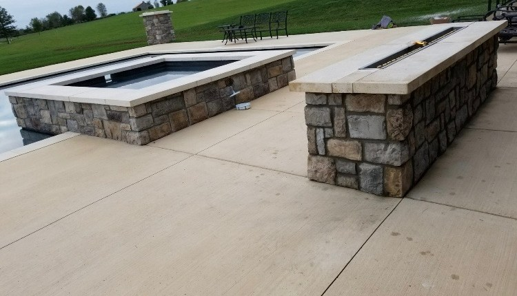 Pool with Built in Spa and Stone Fire Pit