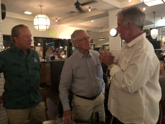 From left to right Carl Peterson, Dick Vermeil and Mike Pound. Mike has is hands folded as if offering a pray and Carl and Dick have bemused looks on their faces.