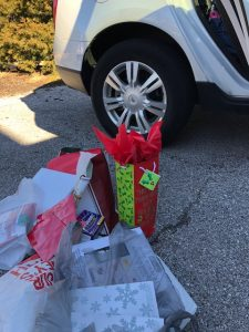 Several Christmas gift items sitting in our driveway waiting for my wife to warp them. In our driveway.