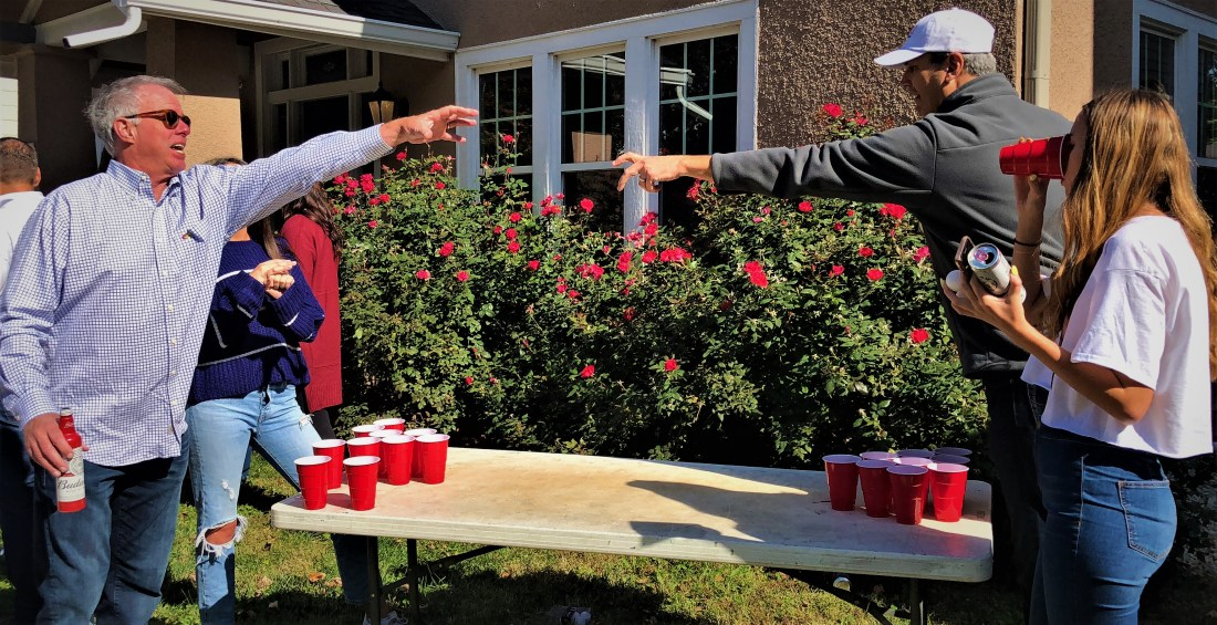this picture shows the importance of stretching before a game of beer-pong