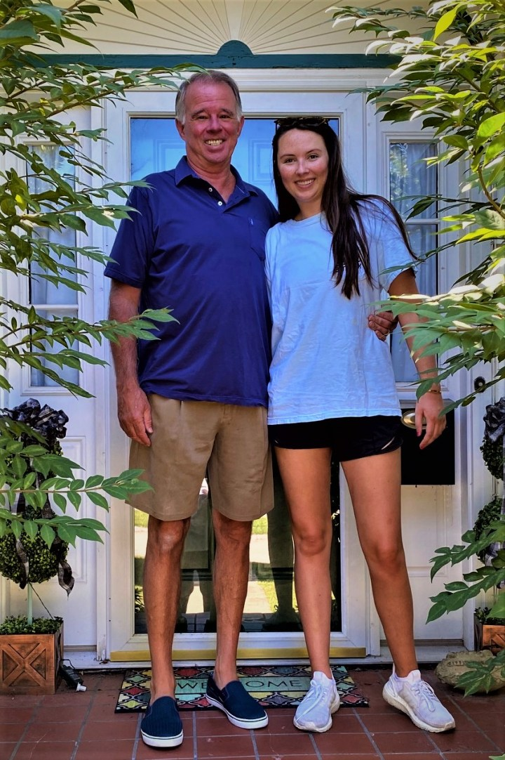 mike and Emma on her last first day of school picture. Emma is just half a head shorter than mike.