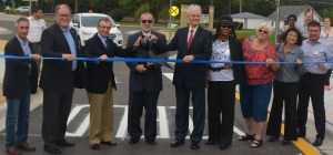 Mike helping to cut the ribbon at the 2016 Sullivan Roundabout ribbon cutting ceremony.