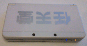 "New 3DS Face with ""Nintendo 1889's"" logo. (The Logo is upside down, and is read as Nintendo)"