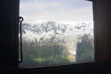 A glance at the Bossons glacier through the window of Refuge de Bellachat