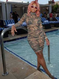 Rocking Gucci shades and a sheer camo dress, Chyna flossed poolside while securing her bag as a party host this weekend. The pink haired stripper turned reality star turned businesswoman avoided dipping all the way into the pool. Because, you know, #blackgirlproblems. But she kept it cute posing it up in all her jewels and such.