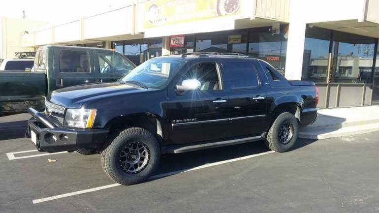 """2010 Chevy Avalanche 3"""" Level Kit, 285/70R17 Toyo Open Country ATII Tires(33"""" Tall) 17X8.5 XD Series Bully Matte Gray w/Black Ring"""