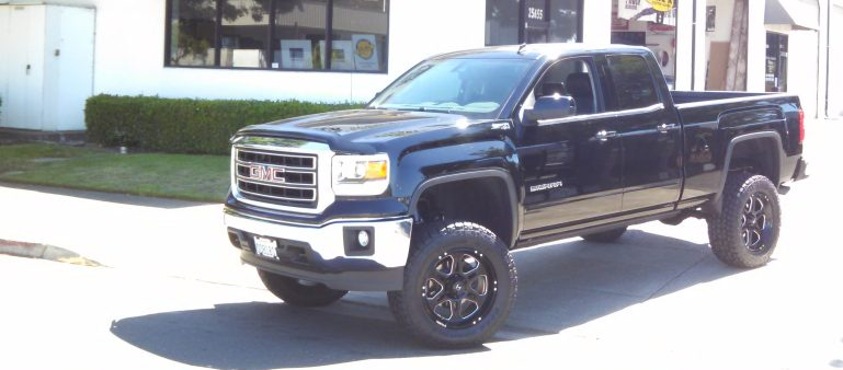 "2015 GMC 1500 4WD 6"" Fabtech Lift, 3.5X12.5 R20 Toyo Open Country ATII Tires, 20X9 Hostile Rims"