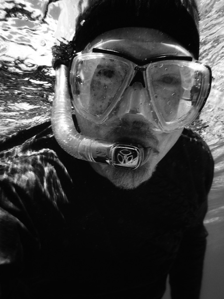 Face with snorkel gear