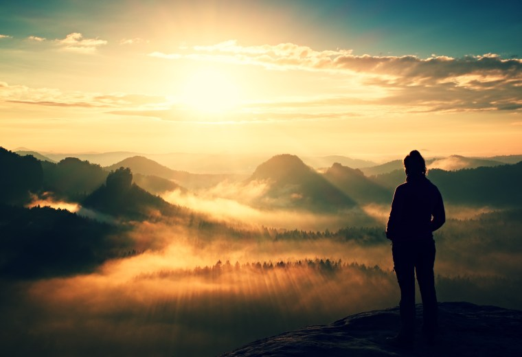 Picture of Woman in the valley at sunrise