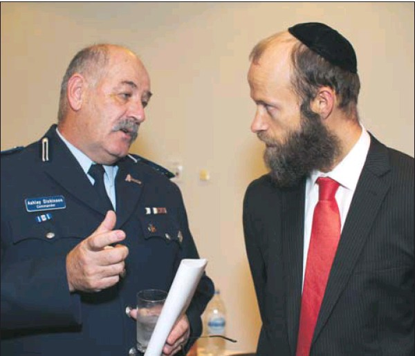 Commander Ashley Dickinson chats with hate-crime victim Menachem Vorchheimer