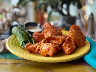 Hand-battered, boneless chicken tenders tossed in buffalo sauce or BBQ