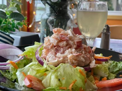 Fresh-picked lobster salad over our garden mix with crisp iceberg, red onion slices, shredded carrots, and tomatoes