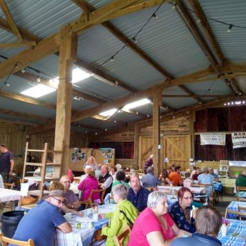 In the barn for tea and cake.