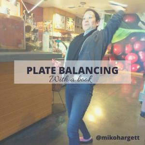 Plate balancing with a book left side - figure 8 for left and right brain balancing.