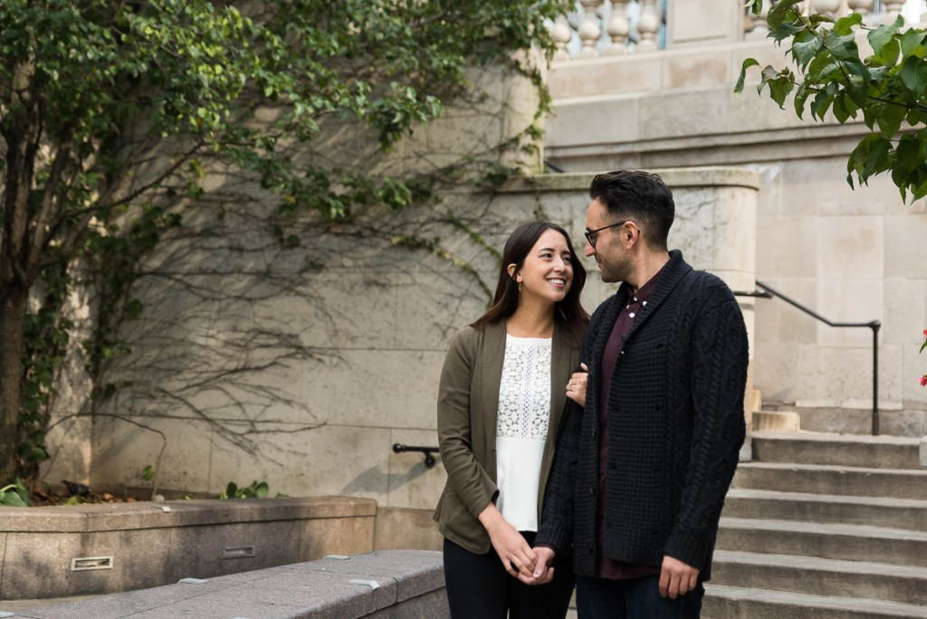 An engagement session for an engaged couple on Riverwalk in downtown Chicago in the fall by a wedding photographer Mila Craila Photography