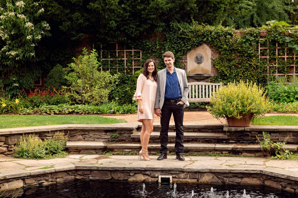 An engagement session for an engaged couple in English garden at Chicago Botanic Garden in the summer by a wedding photographer Mila Craila Photography