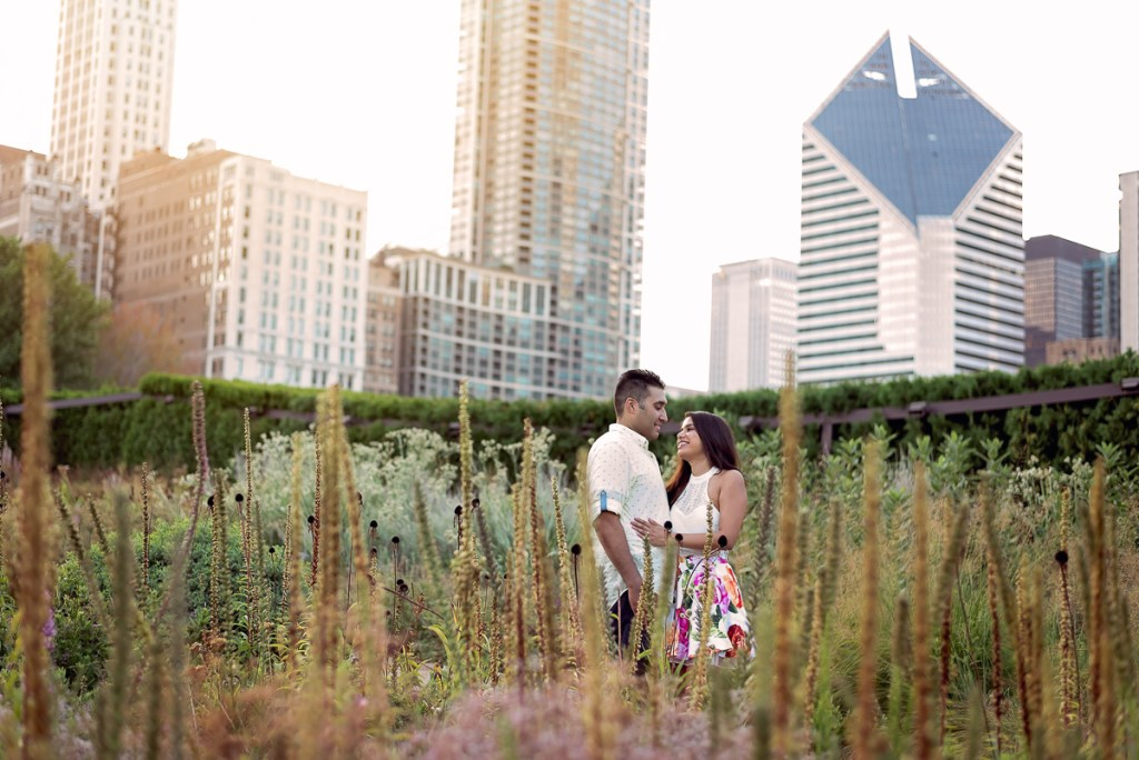An engagement session for an engaged couple in Millennium Park in Chicago in the summer by a wedding photographer Mila Craila Photography