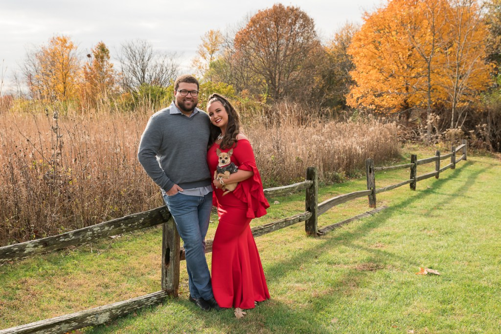 Family session for a couple with a dog at the park in Champaign, Illinois in the fall by family photographer Mila Craila Photography