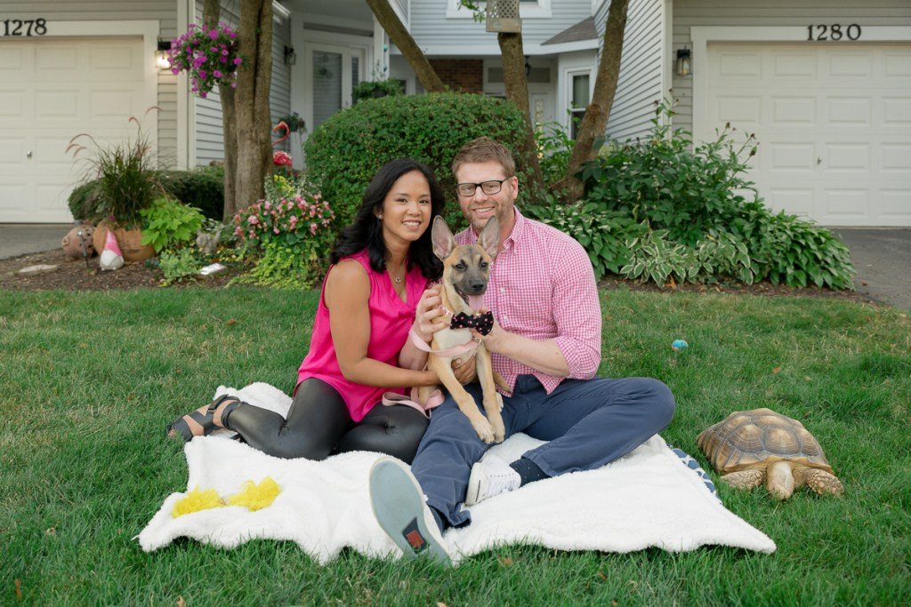 Family session for a couple, a dog and a tortoise in front of their house in Naperville by family photographer Mila Craila Photography